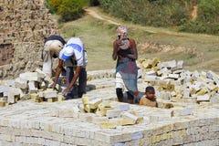 Africans working hard in brickyard. ANTSIRABE, MADAGASCAR, SEPTEMBER 2014, Unknown Africans working hard in brickyard - Madagascar stock image