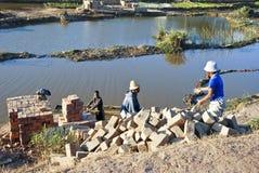 Africans working hard in brickyard. Madagascar royalty free stock image