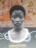 Afrika in Genuas Gasse: eine bestimmte Collage stockbilder