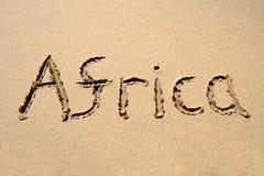 Afrika, geschrieben auf einen Strand Stockbild
