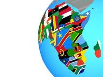 Afrika mit Flaggen auf Kugel lizenzfreie abbildung