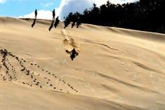 Afrika-Sand Sleding auf einer enormen Düne in Südafrika stockfotografie