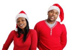 Afrikaans Amerikaans Kerstmispaar met santahoeden Stock Fotografie