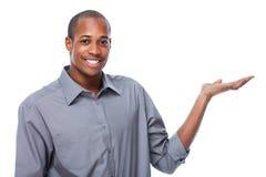 Afrikaans-Amerikaanse zakenman die exemplaarruimte voorstellen stock afbeelding
