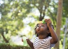 Afrikaans het Huishuis van de Afdalingsfamilie Rustend het Leven Concept stock afbeelding
