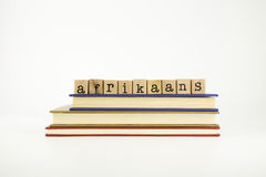Afrikaans language word on wood stamps and books Stock Photos