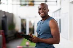Afrikaans mannelijk trainerklembord royalty-vrije stock afbeelding
