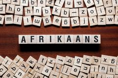 Afrikaans word concept on cubes stock photos