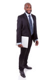 Afrikaanse Amercian bedrijfsmens die een laptopn houdt Stock Afbeelding