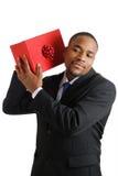 Afrikaanse Amerikaanse bedrijfsmens met Kerstmisgift Stock Foto