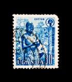Afrikaanse bedrijfsmedewerker, katoenen productie, Onafhankelijkheid van Oeganda serie, circa 1962 van Oeganda Stock Fotografie