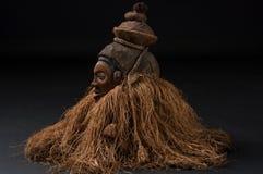 Afrikaanse houten maskers met haar Stock Afbeelding