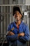 Afrikaanse lasser met masker Stock Afbeelding