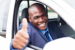 Afrikaanse zakenmanauto Stock Foto's
