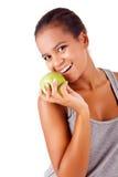 Afrikanerin, die einen Apfel hält Stockfotos