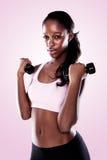 Afrikanische ausarbeitende Frau Lizenzfreie Stockbilder