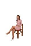 Afrikanische Dame auf Stuhl Stockbild