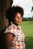 Afrikanische Frau draußen Stockfotografie