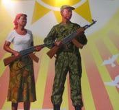 Afrikanische Freiheitskämpfer, die AK47-Gewehre halten Stockfotos