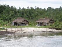 Afrikanische Hütte in den Tropen Stockfotos