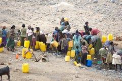 Afrikanische Leute und Wasser lizenzfreies stockfoto