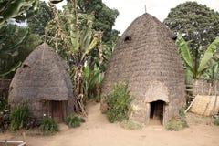 Afrikanische Stammes- Hütten Stockfoto