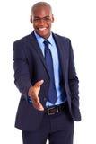 Afrikanischer Geschäftsmanhändedruck Stockbild