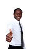 Afrikanischer Geschäftsmann, der sich Daumen zeigt Stockfotos
