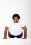 Afrikanischer Mann auf Fußboden Lizenzfreie Stockbilder