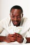 Afrikanischer Mann, der US-Dollars hält Lizenzfreie Stockfotos