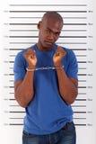 Afrikanischer Mann festgenommen Stockfotos