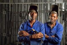 Afrikanischer Schweißer mit Schablone Lizenzfreies Stockbild