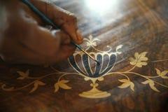 Afrikanischer Tischler Painting Antiques Stockfotografie