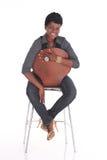 Afrikansk affärskvinna som ner sitter Royaltyfri Fotografi