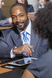 Afrikansk amerikanaffärsman i möte Royaltyfri Foto