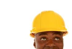 Afrikansk amerikanbyggnadsarbetare som ser upp Fotografering för Bildbyråer