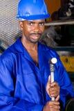 afrikansk amerikanfabriksarbetare arkivbild