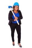 Afrikansk amerikankvinna som rymmer en rivninghammare - svart peop Arkivfoto