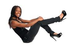Afrikansk amerikankvinnaSitting arkivfoton