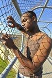 Afrikansk amerikanmodell bak ett staket. Royaltyfria Foton
