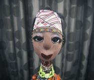 Afrikansk docka på mörk bakgrund Royaltyfri Foto