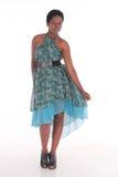 Afrikansk kvinnlig i en blå klänning Royaltyfri Bild
