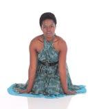 Afrikansk kvinnlig i en blå klänning Fotografering för Bildbyråer