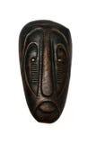 Afrikansk maskering på en isolerad bakgrund Arkivbild