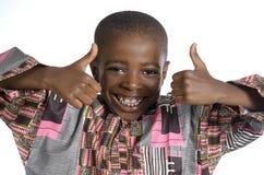 Afrikansk pojkevisningtumme upp Royaltyfria Bilder
