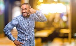 Afrikansk ung man över vit bakgrund royaltyfria foton