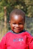 Afrikanska barn som lider från HJÄLPMEDELvirus i byn av Pom Arkivbild