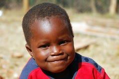 Afrikanska barn som lider från HJÄLPMEDELvirus i byn av Pom Arkivfoto