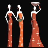 Afrikanska kvinnor i traditionell klänning Arkivbild
