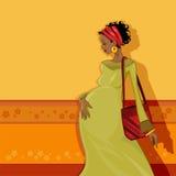 afrikanskt skönhetbarn som förväntar modern Arkivbild